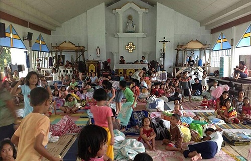 People_take_shelter_in_a_parish_church_in_the_Philippines_after_Typhoon_Haiyan_swept_through_the_area_Credit_Caritas_Manila_CNA_11_11_13